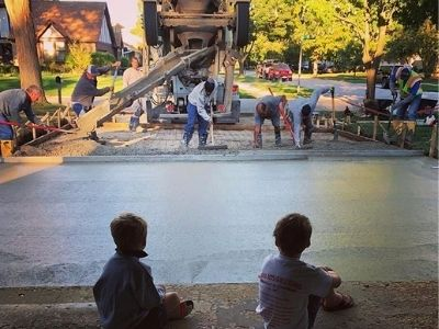 Children Watching Concrete Driveway Construction